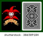 Red Joker Playing Card On Blac...