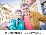 youthful senior couple taking... | Shutterstock . vector #386594089