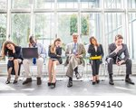 Business People Sitting In A...