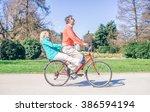 Youthful Senior Couple Riding...