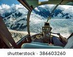 helicopter cockpit flying.... | Shutterstock . vector #386603260