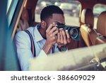 a blackman shooting on dslr... | Shutterstock . vector #386609029