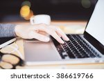 girl typing in laptop with... | Shutterstock . vector #386619766
