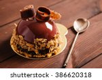 french mousse cake covered with ... | Shutterstock . vector #386620318