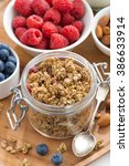 glass jar with homemade granola ... | Shutterstock . vector #386633914