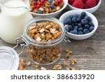 glass jar with granola  milk ... | Shutterstock . vector #386633920