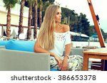 fashion outdoor photo of... | Shutterstock . vector #386653378