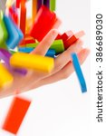 falling colorful domino onto a  ... | Shutterstock . vector #386689030