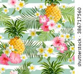 pineapples and tropical flowers ... | Shutterstock .eps vector #386717560