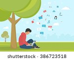 young man sitting in the park... | Shutterstock .eps vector #386723518