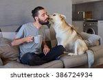 pet owner receiving a kiss lick ... | Shutterstock . vector #386724934
