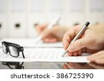 business partners are signing... | Shutterstock . vector #386725390