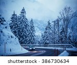 winter road in snow.  mountain... | Shutterstock . vector #386730634