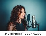 singer. closeup portrait head... | Shutterstock . vector #386771290