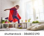 child girl in an superman's... | Shutterstock . vector #386802190