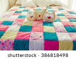 colorful patchwork quilt on the ... | Shutterstock . vector #386818498
