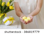 beautiful woman with a gift and ... | Shutterstock . vector #386819779