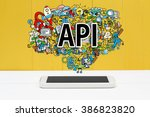 api concept with smartphone on... | Shutterstock . vector #386823820