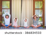 happy young family meditating...