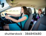 mother driving car and child... | Shutterstock . vector #386840680