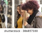 girl looking at shop window | Shutterstock . vector #386857330