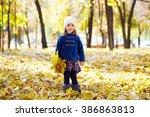 little girl keeps leafs in hand ... | Shutterstock . vector #386863813