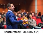 speaker giving a talk on... | Shutterstock . vector #386889514