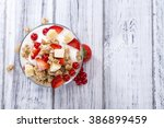 crunchy yoghurt with some fresh ... | Shutterstock . vector #386899459