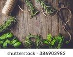 mix of fresh herbs from garden... | Shutterstock . vector #386903983