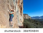 Female Extreme Climber Hanging...