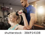 shoulder press with a personal... | Shutterstock . vector #386914108
