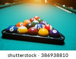 billiard balls in a pool table... | Shutterstock . vector #386938810