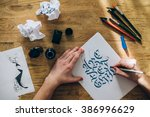 calligraphy master workplace | Shutterstock . vector #386996629