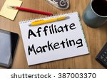 Small photo of Affiliate Marketing - Note Pad With Text On Wooden Table - with office tools