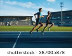 two young men running on race... | Shutterstock . vector #387005878