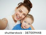 young mother with her one years ... | Shutterstock . vector #387009448