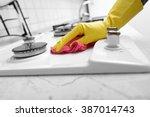 hands in yellow gloves washing... | Shutterstock . vector #387014743