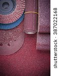 Small photo of Collection of abrasive equipment on polishing paper sheet.