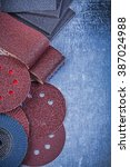 Small photo of Composition of abrasive tools on metallic background top view.