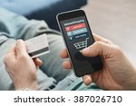 male hands using smart phone... | Shutterstock . vector #387026710