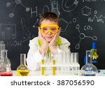 schoolboy  gown and gloves... | Shutterstock . vector #387056590
