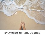 vacation on ocean beach  feet... | Shutterstock . vector #387061888