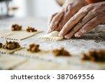 man making ravioli  italian... | Shutterstock . vector #387069556