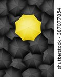 yellow umbrella standing out
