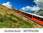 Famous electric red tourist train coming down from the Gornergrat station in Zermatt,Valais region,Switzerland,Europe
