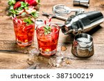 Stock photo red drink with ice cocktail making bar tools strawberry and mint leaves 387100219