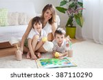 young mother  read a book to... | Shutterstock . vector #387110290