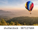 colorful hot air balloon over... | Shutterstock . vector #387127684