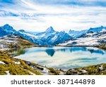 swiss alps water reflection in... | Shutterstock . vector #387144898