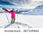 ski  beautiful and young skier... | Shutterstock . vector #387149860